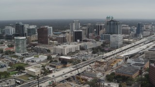 DX0003_233_035 - 5.7K stock footage aerial video slowly fly away from the city's skyline, Downtown Orlando, Florida