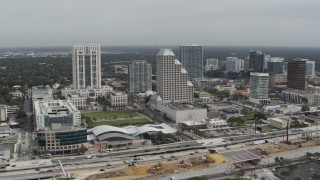 DX0003_233_036 - 5.7K stock footage aerial video slowly approach Bank of America Center in Downtown Orlando, Florida