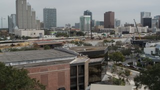 DX0003_233_038 - 5.7K stock footage aerial video descend by the Bob Carr Theater in Orlando, Florida