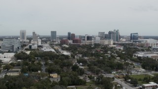 DX0003_233_045 - 5.7K stock footage aerial video wide view of the city's skyline, Downtown Orlando, Florida