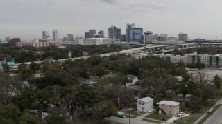 DX0003_234_008 - 5.7K stock footage aerial video ascend past Amway Center, city skyline, freeway interchange, Downtown Orlando, Florida