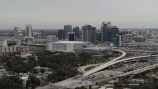 DX0003_234_018 - 5.7K stock footage aerial video of ascending by Amway Center and city skyline, Downtown Orlando, Florida