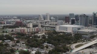 DX0003_234_019 - GLITCH 5.7K stock footage aerial video of an apartment complex, Amway Center and city skyline, Downtown Orlando, Florida