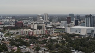 DX0003_234_020 - 5.7K stock footage aerial video of apartment complex, Amway Center and city skyline, Downtown Orlando, Florida