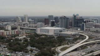 DX0003_234_027 - 5.7K stock footage aerial video flying past Amway Center and city skyline, Downtown Orlando, Florida