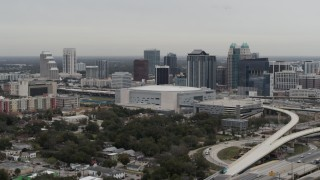 DX0003_234_029 - 5.7K stock footage aerial video of Amway Center arena and city skyline, Downtown Orlando, Florida