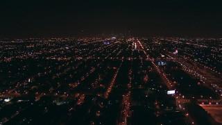 ED0001_000001 - HD stock footage aerial video fly over suburban neighborhoods toward Downtown Chicago, Illinois skyline at night