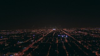 ED0001_000002 - HD stock footage aerial video approach the Downtown Chicago, Illinois skyline from West Side suburbs at night