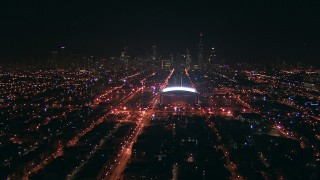 ED0001_000006 - HD stock footage aerial video approach United Center arena and the Downtown Chicago, Illinois skyline at night from the West Side