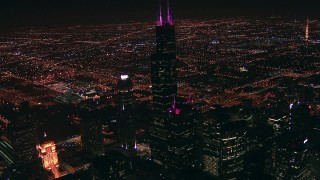 ED0001_000018 - HD stock footage aerial video approach iconic skyscraper, Willis Tower, at night, Downtown Chicago, Illinois