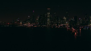ED0001_000030 - HD stock footage aerial video of Downtown Chicago skyline at night seen from Lake Michigan, Illinois