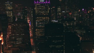 ED0001_000059 - HD stock footage aerial video zoom to a wider view of skyscrapers at night in Downtown Chicago, Illinois