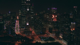 ED0001_000070 - HD stock footage aerial video of city streets and skyscrapers at nighttime in Downtown Chicago, Illinois