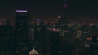 ED0001_000085 - HD stock footage aerial video of Willis Tower skyscraper, and reveal John Hancock Center at night, Downtown Chicago, Illinois