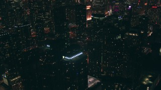 ED01_088 - HD stock footage aerial video tilt from Lake Michigan to reveal and approach skyscrapers, Downtown Chicago, Illinois at nighttime