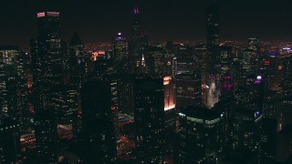 ED01_089 - HD stock footage aerial video of a wide view of skyscrapers at night seen while flying over Downtown Chicago, Illinois