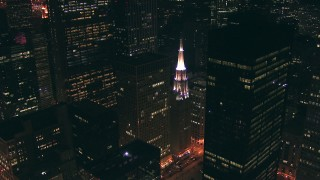 ED01_091 - HD stock footage aerial video approach Chicago Temple Building and skyscrapers at night in Downtown Chicago, Illinois