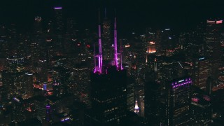 ED01_099 - HD stock footage aerial video orbit the spires on top of Willis Tower skyscraper at night, Downtown Chicago, Illinois