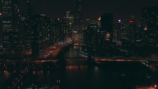 ED01_108 - HD stock footage aerial video approach the Chicago River at night with a view of Trump Tower skyscraper, Downtown Chicago, Illinois