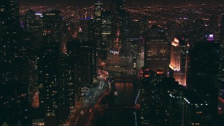 ED01_109 - HD stock footage aerial video follow the Chicago River toward Trump Tower skyscraper at night, Downtown Chicago, Illinois