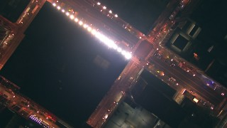 ED01_111 - HD stock footage aerial video of a bird's eye view of wide streets at night in Downtown Chicago, Illinois