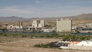 FG0001_000002 - 4K stock footage aerial video of desert hotels and casinos across the Colorado River in Laughlin, Nevada