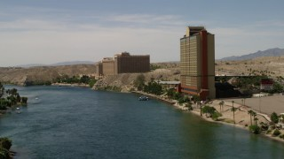 FG0001_000006 - 4K stock footage aerial video follow the Colorado River past resort casinos in Laughlin, Nevada