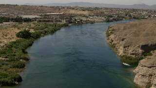 FG0001_000009 - 4K stock footage aerial video follow the Colorado River past a small riverfront hotel in Bullhead City, Arizona