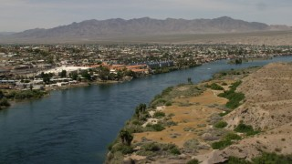 FG0001_000011 - 4K stock footage aerial video pan across riverfront homes and apartments on the Colorado River in Bullhead City, Arizona