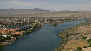FG0001_000012 - 4K stock footage aerial video of apartment buildings and homes on the Colorado River in Bullhead City, Arizona