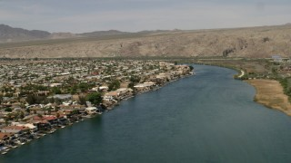 FG0001_000014 - 4K stock footage aerial video of waterfront homes with docks beside the Colorado River in Bullhead City, Arizona