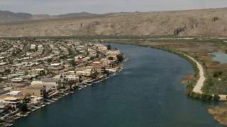 FG0001_000015 - 4K stock footage aerial video of waterfront houses and docks on the Colorado River in Bullhead City, Arizona