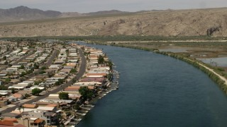 FG0001_000016 - 4K stock footage aerial video follow a bend in the Colorado River past waterfront houses and docks in Bullhead City, Arizona