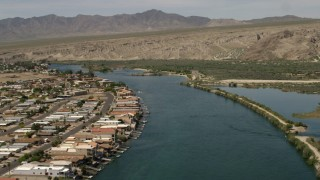 FG0001_000017 - 4K stock footage aerial video of a bend in the Colorado River and waterfront houses with docks in Bullhead City, Arizona
