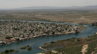 FG0001_000020 - 4K stock footage aerial video of residential neighborhood beside the Colorado River in Bullhead City, Arizona