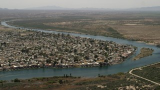 FG0001_000021 - 4K stock footage aerial video of waterfront residential neighborhood on the Colorado River in Bullhead City, Arizona
