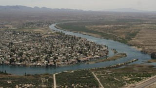 FG0001_000022 - 4K stock footage aerial video of waterfront neighborhood on the Colorado River in Bullhead City, Arizona