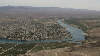 FG0001_000023 - 4K stock footage aerial video of riverfront neighborhood on the Colorado River in Bullhead City, Arizona