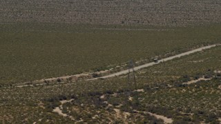 FG0001_000034 - 4K stock footage aerial video of a bus traveling on a lonely Mojave Desert highway in Laughlin, Nevada