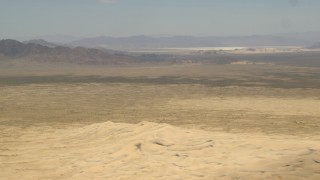 FG0001_000053 - Aerial stock footage of Mojave Desert mountains across a rugged plain in San Bernardino County, California