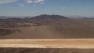 FG0001_000062 - 4K stock footage aerial video of a dry lake and Mojave Desert mountains in San Bernardino County, California