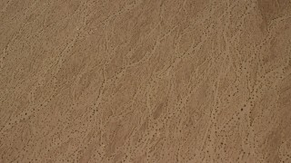 FG0001_000069 - 4K stock footage aerial video of a bird's eye view of a flat Mojave Desert plain in San Bernardino County, California