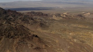 FG0001_000079 - 4K stock footage aerial video of the Pisgah Crater behind rugged Mojave Desert mountains in San Bernardino County, California