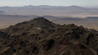 FG0001_000082 - 4K stock footage aerial video of the rugged summit of a Mojave Desert mountain in San Bernardino County, California