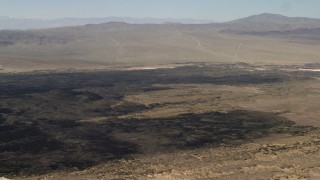 FG0001_000086 - 4K stock footage aerial video pan across Pisgah Crater and lava field in Mojave Desert, San Bernardino County, California