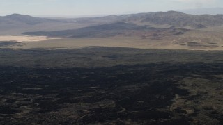 FG0001_000088 - 4K stock footage aerial video pan across the lava fields by the Pisgah Crater in Mojave Desert, San Bernardino County, California