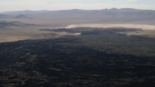 FG0001_000090 - 4K stock footage aerial video of the lava fields of the Pisgah Crater in the Mojave Desert, San Bernardino County, California