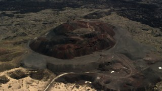 FG0001_000093 - 4K stock footage aerial video of a reverse view of the Pisgah Crater cinder cone in the Mojave Desert, San Bernardino County, California