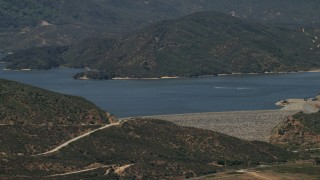 FG0001_000127 - 4K stock footage aerial video approach the dam as speedboats cruise across Silverwood Lake, California