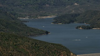 FG0001_000130 - 4K stock footage aerial video of watercraft race across Silverwood Lake in California